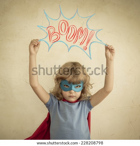 Winner superhero child against grunge wall background. Kid playing at home. Success concept - stock photo
