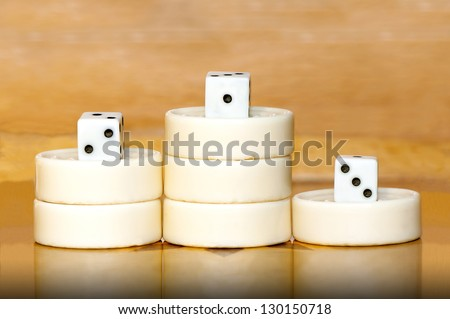 Winners podium from backgammon white pieces and dices with scores - stock photo