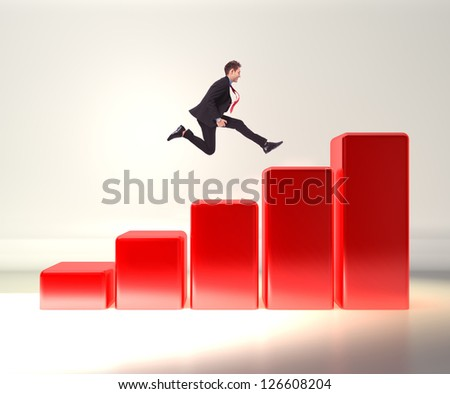 winning business man jumping o top of a 3d graph - stock photo
