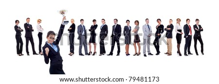 winning business team with female executive holding a gold trophy - stock photo