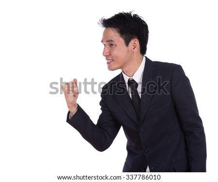 winning businessman isoalted on a white background - stock photo