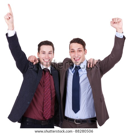 winning businessmen holding each other by their shoulders and gesturing success