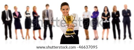 winning businessteam with female executive holding a gold trophy
