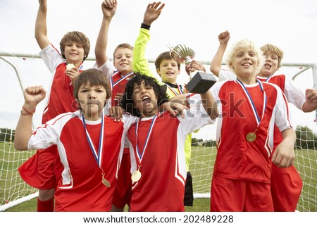 Winning junior soccer team portrait - stock photo