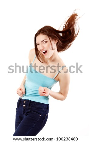 Winning teen girl happy ecstatic gesturing success. Isolated on white background. - stock photo