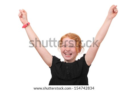 Winning young girl with arms up on white background - stock photo