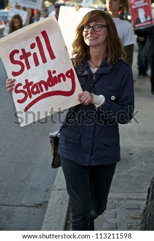 WINNIPEG, CANADA - SEPTEMBER 17: An unidentified female demonstrator marches in Occupy Winnipeg's observance of Occupy Wall Street's first anniversary on September 17, 2012 in Winnipeg. - stock photo