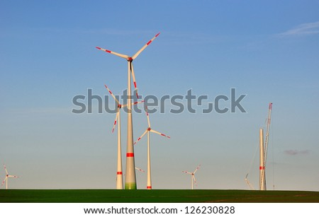 Wins generators against blue sky, wind generator under construction. - stock photo