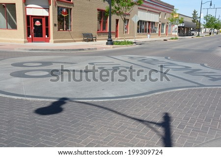 "WINSLOW, AZ/USA - MAY 15: ""Standin' On The Corner Park"", on Route 66, pays homage to ""Take It Easy"", by Jackson Browne and popularized by the rock group Eagles, on May 15, 2014, in Winslow, Arizona. - stock photo"