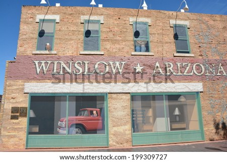 "WINSLOW, AZ/USA - MAY 15: ""Standin' On The Corner Park"", on Route 66, pays homage to ""Take It Easy"", by Jackson Browne and popularized by the rock group Eagles, on May 15, 2014, in Winslow, Arizona."
