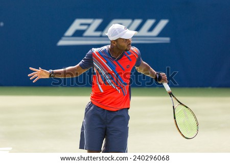 WINSTON-SALEM, NC, USA - AUGUST 20: Donald Young plays on center court at the Winston-Salem Open on August 20, 2014 in Winston-Salem, NC, USA - stock photo