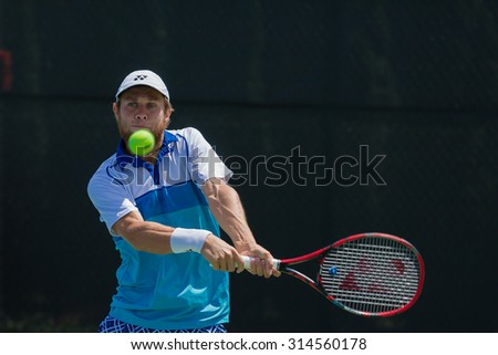 WINSTON-SALEM, NC, USA - AUGUST 22: Radu Albot competes at the Winston-Salem Open on August 22, 2015 in Winston-Salem, NC, USA