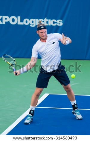 WINSTON-SALEM, NC, USA - AUGUST 23: Sam Groth plays center court at the Winston-Salem Open on August 23, 2015 in Winston-Salem, NC, USA