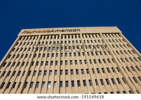 WINSTON-SALEM, NC, USA JUNE 3: RJR Plaza Building on June 3, 2013 in Winston-Salem, NC. Built in 1982 and currently the headquarters of the R. J. Reynolds Tobacco Company. - stock photo