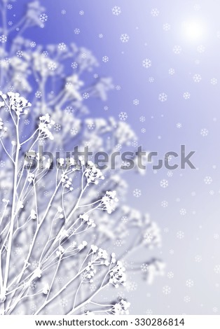 Winter abstract defocused background. Snowflakes background with white snowy flowers. Snow falling over blue bokeh winter backdrop. Blurred field flowers in Holidays winter background. - stock photo