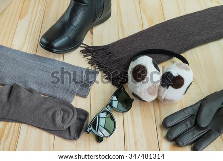 Winter accessories including clothing, gloves, boots, scarf, sunglasses, hose and earmuff