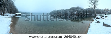 Winter Alpsee lake panorama and Hohenschwangau Castle on right. - stock photo