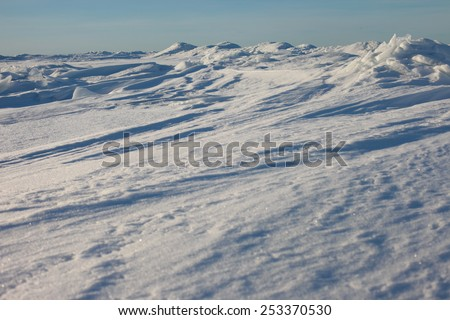 Winter arctic landscape, icy desert. The ridges in the sea, snowy hills on a frozen plain - stock photo