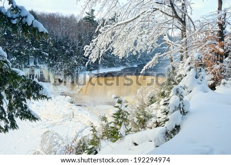 Winter at Tahquamenon Falls, Upper Michigan Waterfall - stock photo