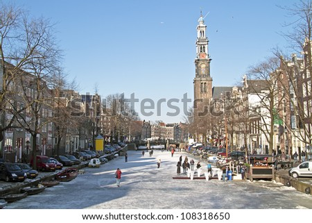 Winter at the Prinsengracht with the Westerkerk in Amsterdam the Netherlands - stock photo