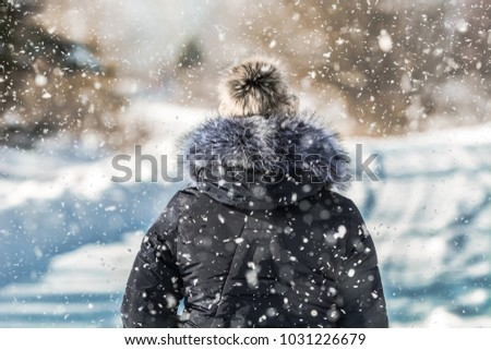 WINTER ATTACK - Woman walking through the blizzard
