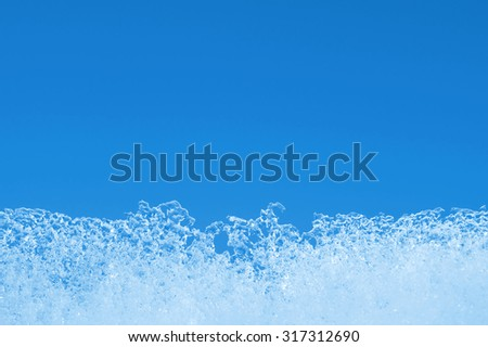 Winter background. An ice edge against the blue sky. - stock photo