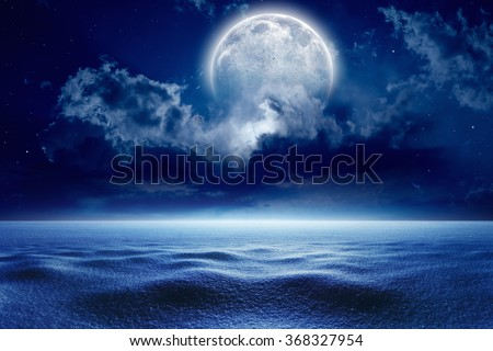 Winter background - cold winter night sky with full moon, winter weather with snow. Elements of this image furnished by NASA - stock photo