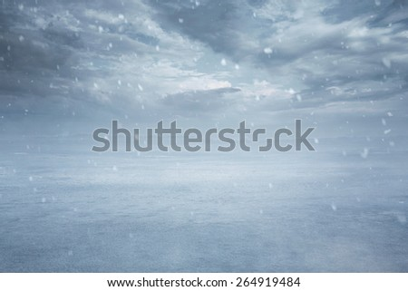 Winter background, empty frozen lake while snowing with copy space - stock photo