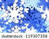 Winter background of blue and white snowflake confetti - stock photo