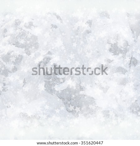 Winter background of frozen window and stars