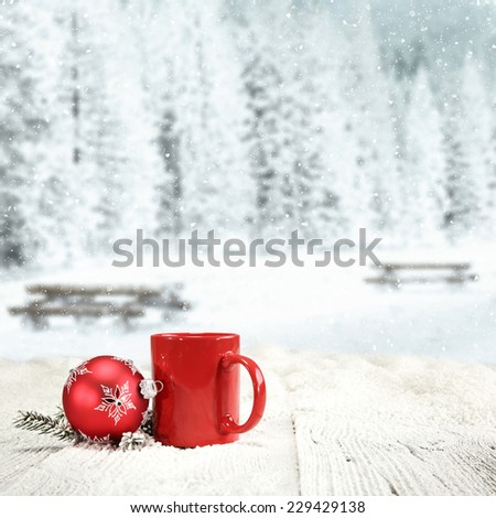 winter background of wooden old table with landscape of park in snow and ball of red mug and free space  - stock photo