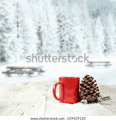 winter background of wooden old table with landscape of park in snow and cone mug and tree  - stock photo