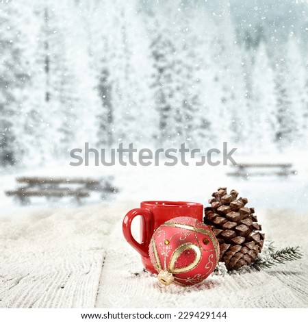 winter background of wooden old table with landscape of park in snow and red mug  - stock photo