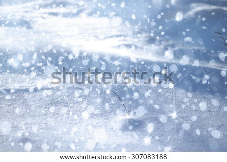 Winter background, snowfall, lights and stars. - stock photo
