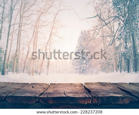 Winter background. Winter snow landscape with wooden table - stock photo