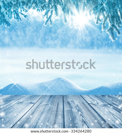 Winter background with a wooden table in the foreground - stock photo