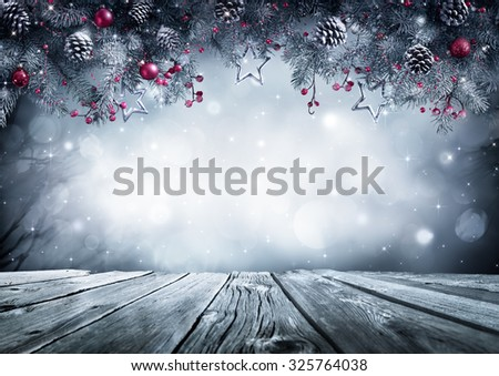 Winter background with frost fir branch and wooden planks  - stock photo