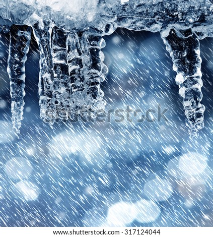 winter background with icicles and empty space - stock photo