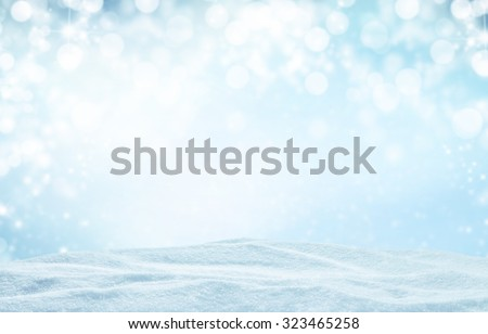 Winter background with pile of snow and blur abstract lights. Copyspace for text - stock photo