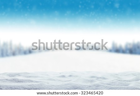 Winter background with pile of snow and blur landscape. Copyspace for text - stock photo