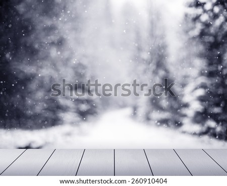 winter background with snowflakes and boards - stock photo