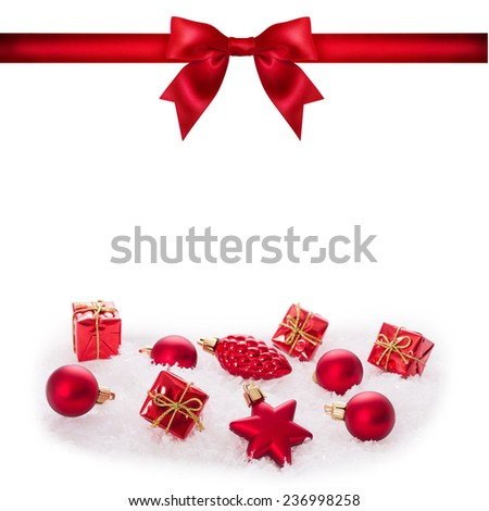 Winter background with spruce twigs, red baubles and ribbon bow. Christmas  - stock photo