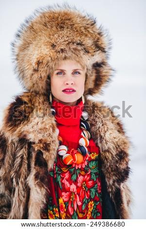 Winter beautiful Girl in Luxury Fur Coat and hat. Fashion Fur.  - stock photo