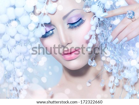 Winter Beauty Woman. Beautiful Fashion Model Girl with Snow Hair style and Make up. Holiday Makeup and Manicure. Winter Queen  - stock photo