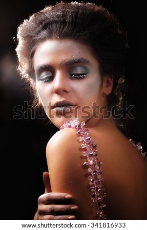 Winter Beauty Woman. Christmas Girl Makeup. Beautiful Make-up with False Eyelashes and crystals on her Lips. Snow girl.