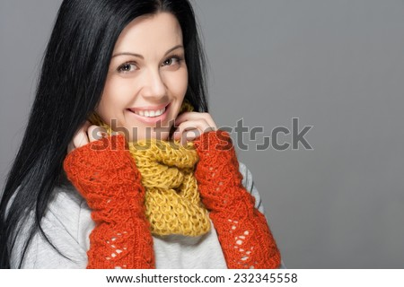 Winter Beauty Woman. Fashion Girl Concept. Skin and hair care in cold season. Beautiful woman with long hair wearing a sweater, scarf, hat and gloves. Holiday Fashion Portrait. - stock photo