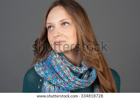 Winter Beauty Woman. Fashion Girl Concept. Skin and hair care in cold season. Beautiful woman with long hair wearing a sweater, scarf, hat and gloves. Holiday Fashion Portrait.