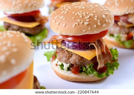 Winter beef burger with bacon,cheese and vegetables,selective focus - stock photo