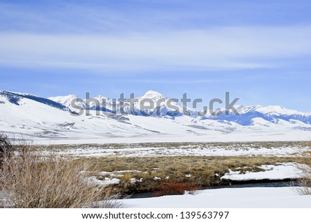 Winter blankets the Lemhi Valley and Mountain Range with Diamond Peak rising into the sky.
