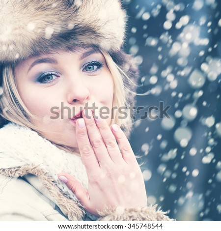 Winter Blond Hair Woman in Fur Hat. Beautiful Girl Kissing - stock photo